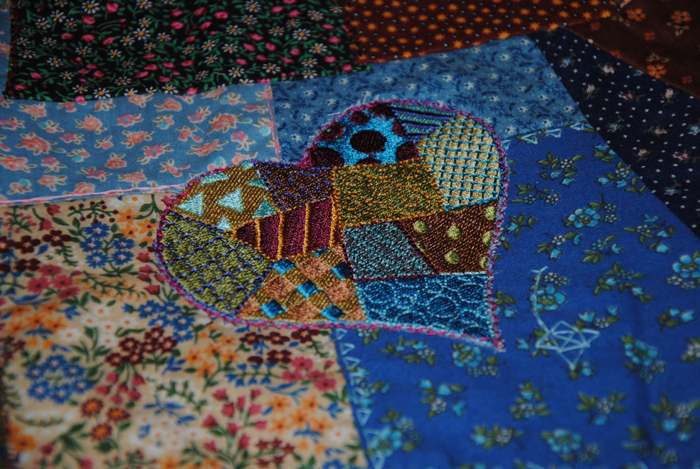 A patchwork embroidery piece I added to one of her crazy quilts.